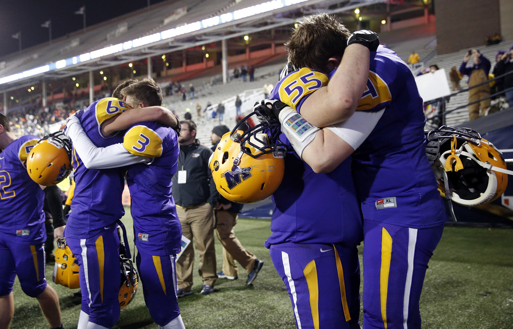 Williamsville's Alec Daykin consoles teammate Mitch Whitley after the Bullets lost to Wilmington during the Class 3A football championship game at Memorial Stadium Friday, Nov. 28, 2014. Ted Schurter/The State Journal-Register