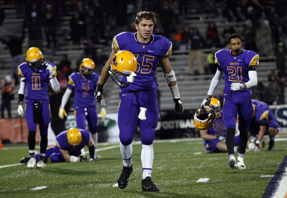 Williamsville's John Karras tosses his helmet after the Bullets lost to Wilmington during the Class 3A football championship game at Memorial Stadium Friday, Nov. 28, 2014. Ted Schurter/The State Journal-Register