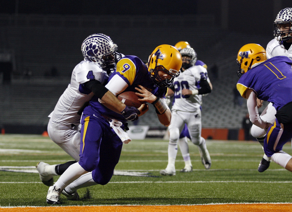 Williamsville's Luke Bleyer plows into the endzone for a touchdown against Wilmington during the Class 3A football championship game at Memorial Stadium Friday, Nov. 28, 2014. Ted Schurter/The State Journal-Register