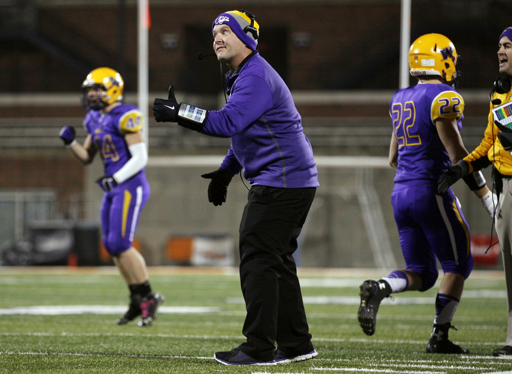 Williamsville head coach Aaron Kunz encourages his team after a field goal against Wilmington during the Class 3A football championship game at Memorial Stadium Friday, Nov. 28, 2014. Ted Schurter/The State Journal-Register