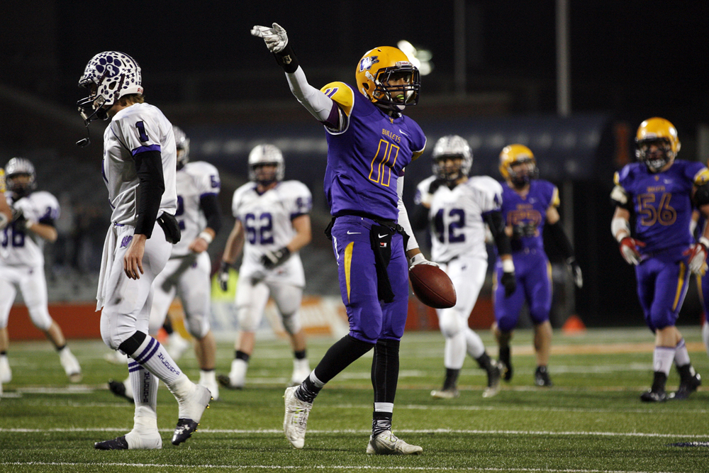 Williamsville's D'ante' Cox signals for a first down after picking one up against Wilmington during the Class 3A football championship game at Memorial Stadium Friday, Nov. 28, 2014. Ted Schurter/The State Journal-Register