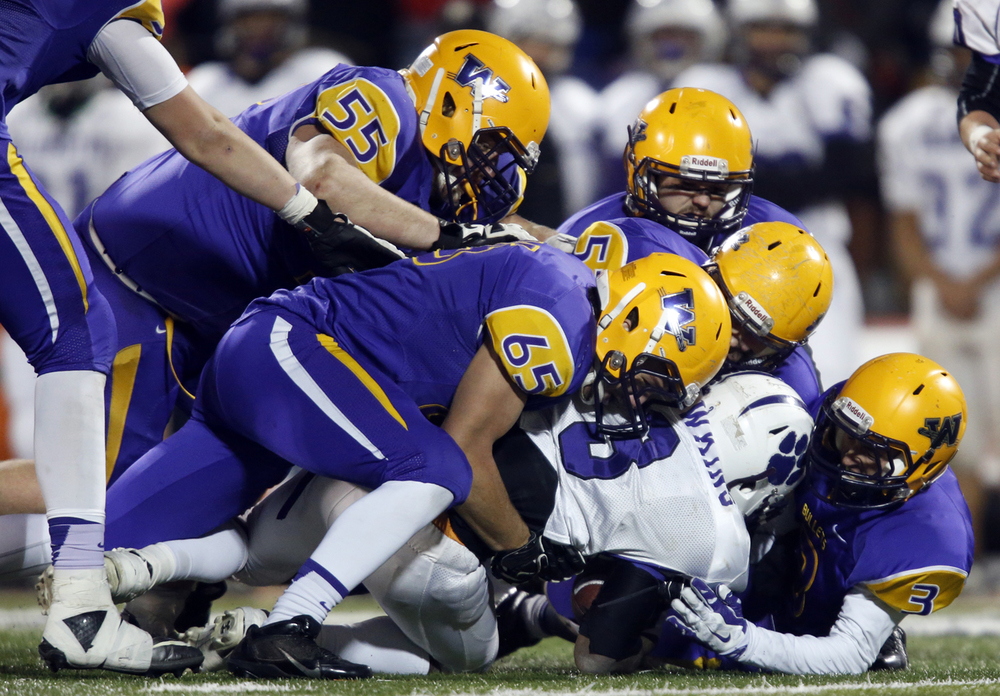 Williamsville's defense brings down Wilmington's Jordan Sarr during the Class 3A football championship game at Memorial Stadium Friday, Nov. 28, 2014. Ted Schurter/The State Journal-Register