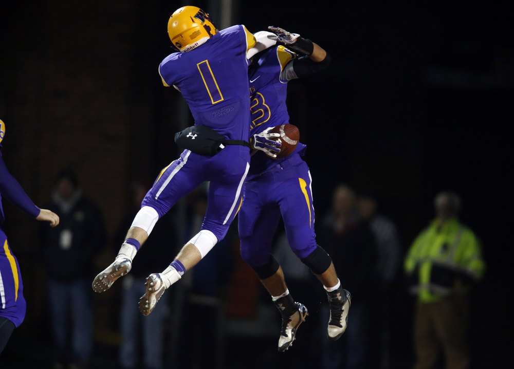 Williamsville's Daniel Daykin leaps onto Jace Franklin after his touchdown against Wilmington during the Class 3A football championship game at Memorial Stadium Friday, Nov. 28, 2014. Ted Schurter/The State Journal-Register