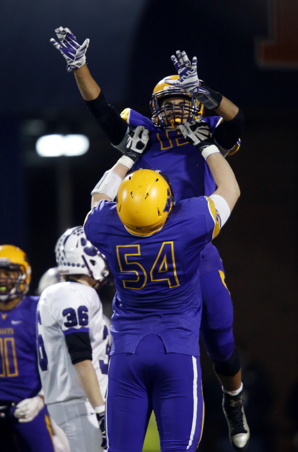 Williamsville's Mitch Whitley hoists Jace Franklin in the air after his long touch down run against Wilmington during the Class 3A football championship game at Memorial Stadium Friday, Nov. 28, 2014. Ted Schurter/The State Journal-Register