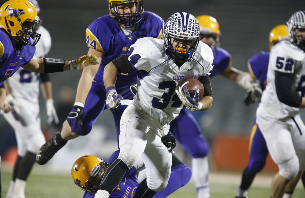 Wilmington's Nick McWilliams runs the ball against Williamsville during the Class 3A football championship game at Memorial Stadium Friday, Nov. 28, 2014. Ted Schurter/The State Journal-Register