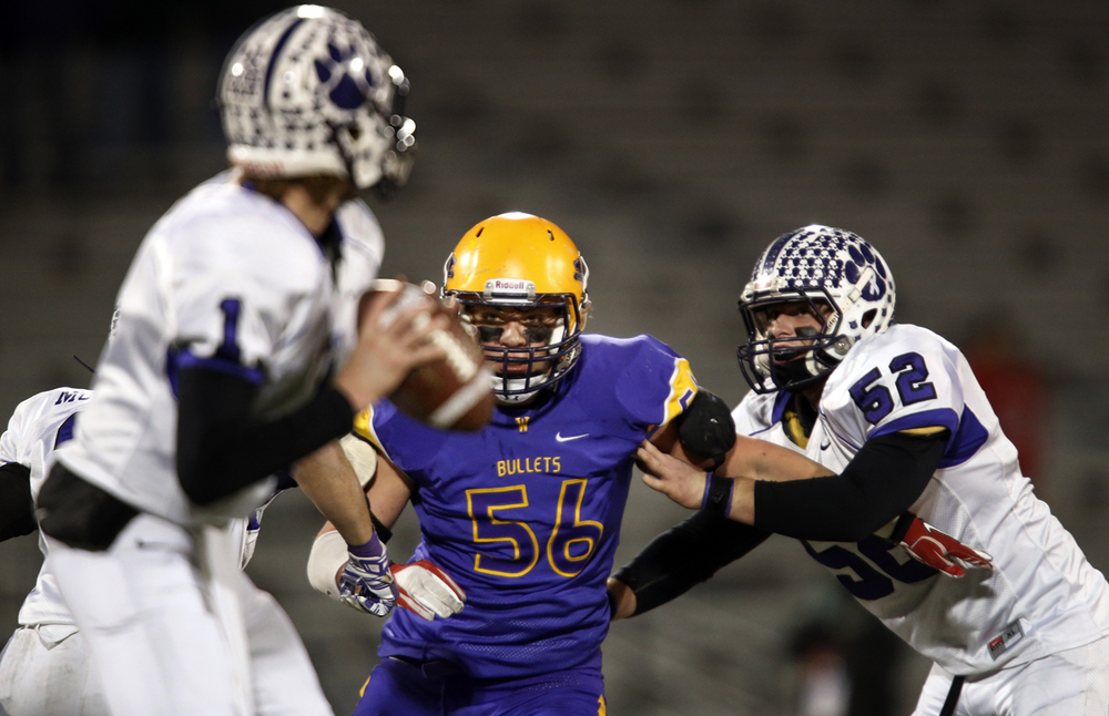 Williamsville's Riley Perrine closes in on Wilmington quarterback Mason Southall during the Class 3A football championship game at Memorial Stadium Friday, Nov. 28, 2014. Ted Schurter/The State Journal-Register