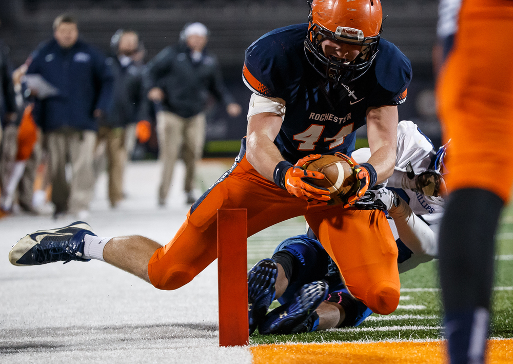 Rochester's Adam Conrady (44) dives in for a touchdown against Chicago Phillips' Jamal Brown (23) in the first half during the IHSA Class 4A state championship game at Memorial Stadium, Friday, Nov. 28, 2014, in Champaign, Ill. Justin L. Fowler/The State Journal-Register