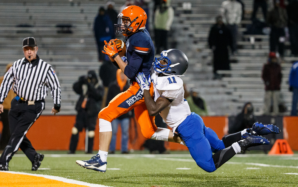 Rochester's Collin Etherton (11) goes in for a 34-yard touchdown catch against Chicago Phillips' Corey Warren (11) in the first half during the IHSA Class 4A state championship game at Memorial Stadium, Friday, Nov. 28, 2014, in Champaign, Ill. Justin L. Fowler/The State Journal-Register