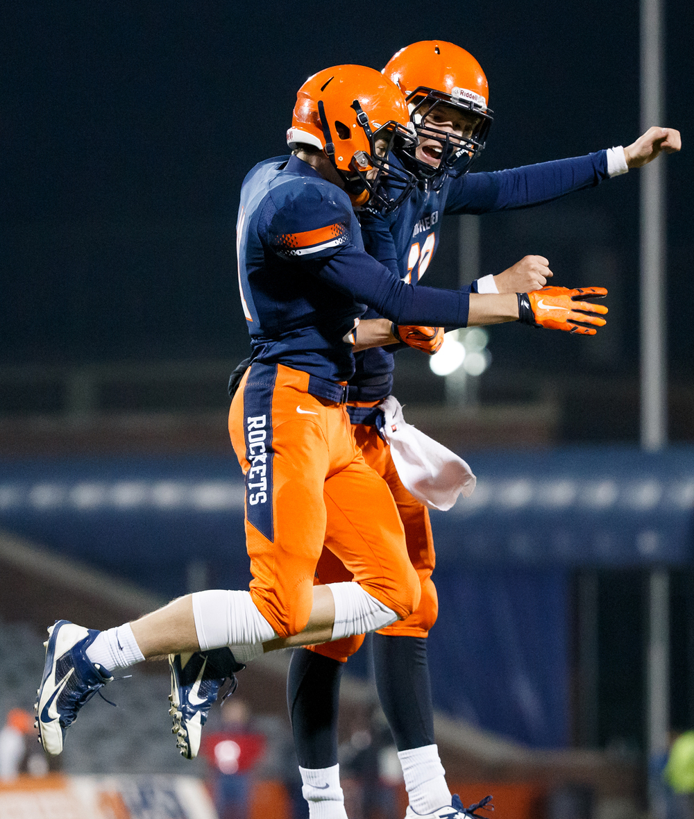 Rochester's Collin Etherton (11) celebrates his touchdown with quarterback Dan Zeigler (10) to make it 25-12 in the first half during the IHSA Class 4A state championship game at Memorial Stadium, Friday, Nov. 28, 2014, in Champaign, Ill. Justin L. Fowler/The State Journal-Register