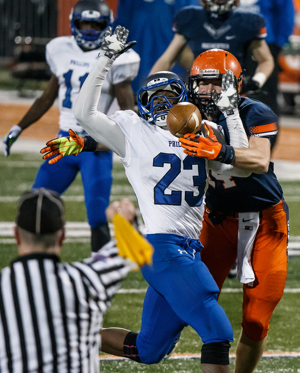 Rochester's Adam Conrady (44) gets called for offensive pass interference going for a catch against Chicago Phillips' Jamal Brown (23) in the first half during the IHSA Class 4A state championship game at Memorial Stadium, Friday, Nov. 28, 2014, in Champaign, Ill. Justin L. Fowler/The State Journal-Register