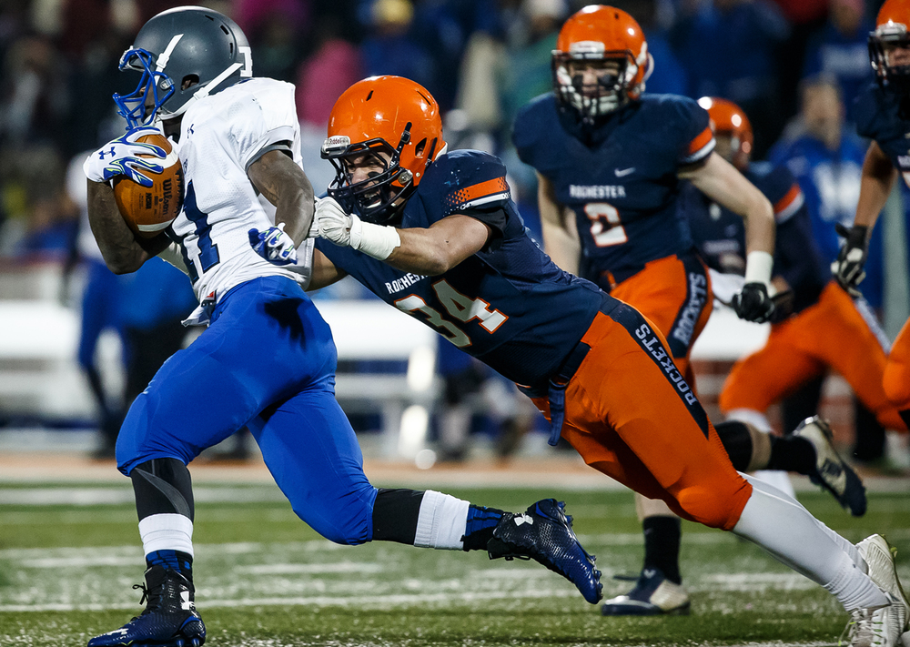 Rochester's Evan Sembell (34) leaps out to bring down Chicago Phillips' Corey Warren (11) on a rush in the first half during the IHSA Class 4A state championship game at Memorial Stadium, Friday, Nov. 28, 2014, in Champaign, Ill. Justin L. Fowler/The State Journal-Register