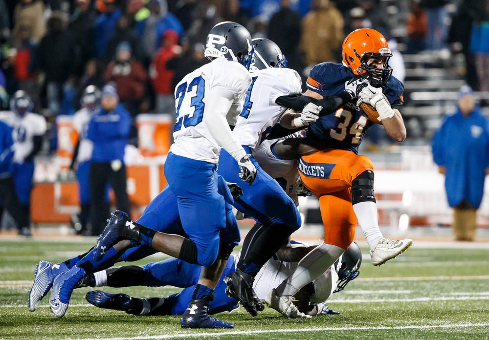 Rochester's Evan Sembell (34) fights to stay up against Chicago Phillips on a rush in the second half during the IHSA Class 4A state championship game at Memorial Stadium, Friday, Nov. 28, 2014, in Champaign, Ill. Justin L. Fowler/The State Journal-Register