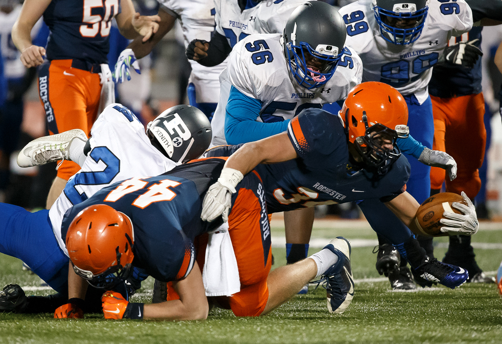 Rochester's Evan Sembell (34) dives to try and get a first down as he is brought down by Chicago Phillips' David Munson (24) in the second half during the IHSA Class 4A state championship game at Memorial Stadium, Friday, Nov. 28, 2014, in Champaign, Ill. Justin L. Fowler/The State Journal-Register