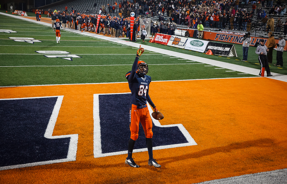 Rochester's Collin Stallworth (84) points to the sky after scoring a touchdown against Chicago Phillips  in the second half during the IHSA Class 4A state championship game at Memorial Stadium, Friday, Nov. 28, 2014, in Champaign, Ill. Justin L. Fowler/The State Journal-Register