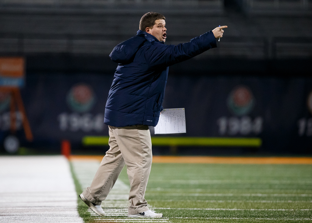 Rochester head football coach Derek Leonard calls out a play to his team as they take on Chicago Phillips in the first half during the IHSA Class 4A state championship game at Memorial Stadium, Friday, Nov. 28, 2014, in Champaign, Ill. Justin L. Fowler/The State Journal-Register