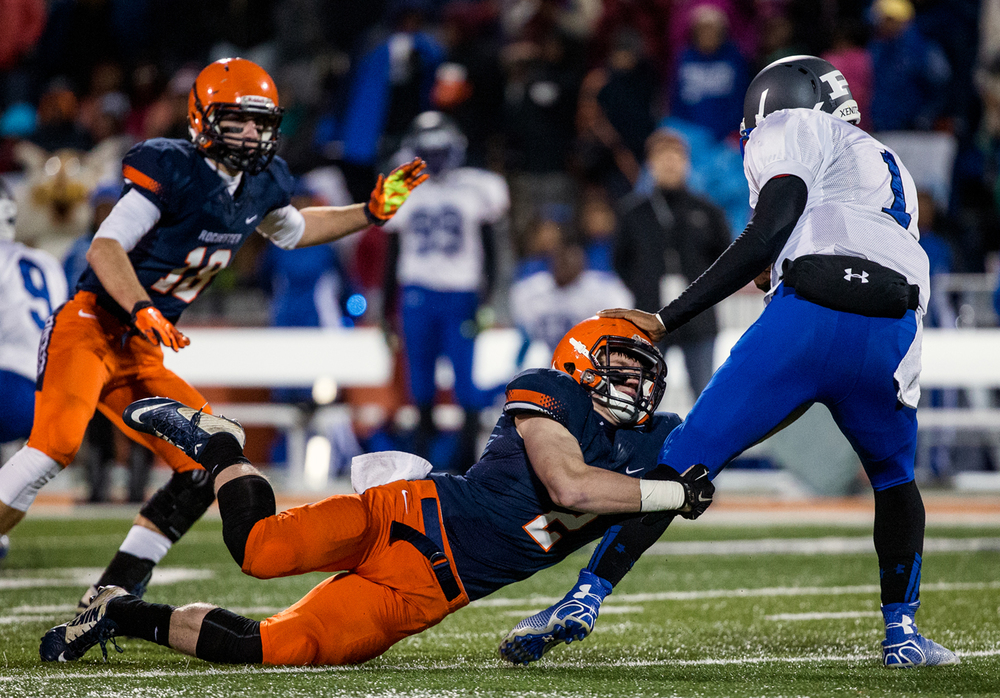 Rochester's Eric Yakle (2) brings down Chicago Phillips quarterback Dewayne Collins (1) in the backfield as he scrambles out of the pocket in the first half during the IHSA Class 4A state championship game at Memorial Stadium, Friday, Nov. 28, 2014, in Champaign, Ill. Justin L. Fowler/The State Journal-Register