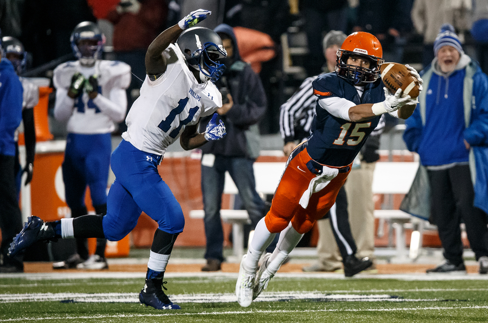 Rochester's Jeremy Bivens (15) makes a leaping catch in front of Chicago Phillips' Corey Warren (11) in the first half during the IHSA Class 4A state championship game at Memorial Stadium, Friday, Nov. 28, 2014, in Champaign, Ill. Justin L. Fowler/The State Journal-Register