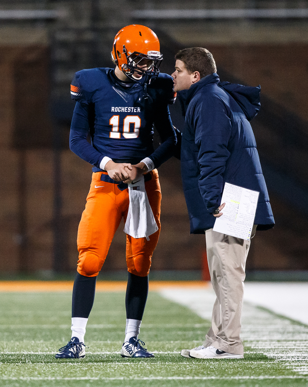 Rochester head football coach Derek Leonard takes with Rochester's quarterback Dan Zeigler (10) along the sideline as they take on Chicago Phillips in the first half during the IHSA Class 4A state championship game at Memorial Stadium, Friday, Nov. 28, 2014, in Champaign, Ill. Justin L. Fowler/The State Journal-Register