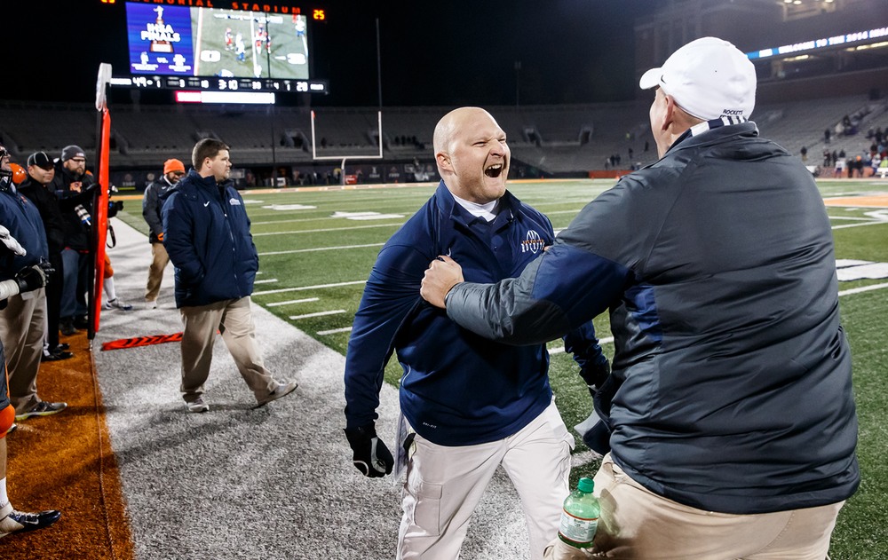 Rochester defensive coordinator Steve Buecker celebrates with the coaches as the Rockets take their fifth straight title against Chicago Phillips in the IHSA Class 4A state championship game at Memorial Stadium, Friday, Nov. 28, 2014, in Champaign, Ill. Justin L. Fowler/The State Journal-Register