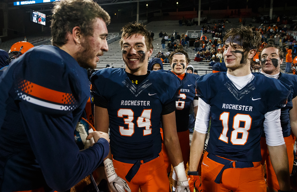 Rochester's Tyler Schlecht (31) Evan Sembell (34)  and  Tyler Mazzini (18) start to celebrate as the Rockets take their fifth straight title defeating Chicago Phillips in the IHSA Class 4A state championship game at Memorial Stadium, Friday, Nov. 28, 2014, in Champaign, Ill. Justin L. Fowler/The State Journal-Register