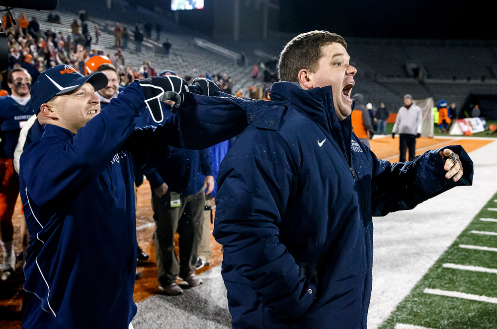 Rochester defensive coordinator Steve Buecker flips a hoodie of cold water back on to Rochester head football coach Derek Leonard after the Rockets take their fifth straight title against Chicago Phillips in the IHSA Class 4A state championship game at Memorial Stadium, Friday, Nov. 28, 2014, in Champaign, Ill. Justin L. Fowler/The State Journal-Register