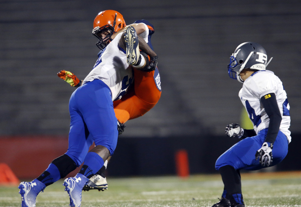 Chicago Phillips' Amani Jones tackles Rochester's Tyler Mazzini during the Class 4A football championship game at Memorial Stadium Friday, Nov. 28, 2014. Ted Schurter/The State Journal-Register