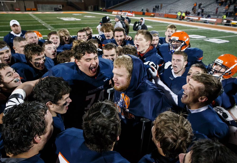 The Rockets surround their injured teammate Rochester's Tyler Cotton (71) as they celebrate their victory over Chicago Phillips in the IHSA Class 4A state championship game at Memorial Stadium, Friday, Nov. 28, 2014, in Champaign, Ill. Justin L. Fowler/The State Journal-Register