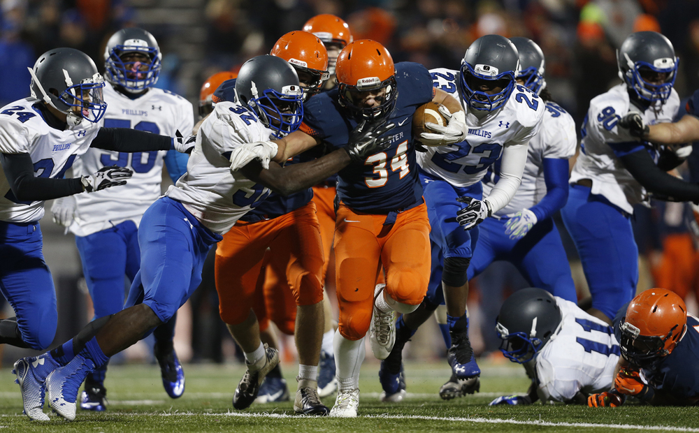 Rochester's Evan Sembell runs the ball upfield against Chicago Phillips during the Class 4A football championship game at Memorial Stadium Friday, Nov. 28, 2014. Ted Schurter/The State Journal-Register