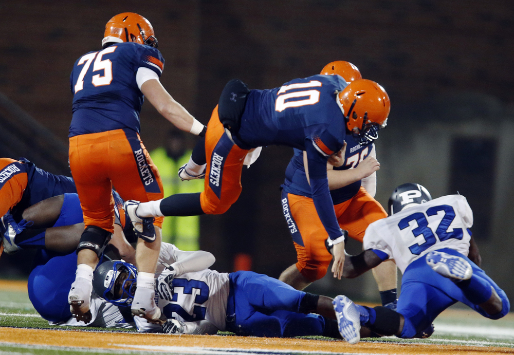 Rochester's Danny Zeigler dives forward on a quarterback sneak against Chicago Phillips during the Class 4A football championship game at Memorial Stadium Friday, Nov. 28, 2014. Ted Schurter/The State Journal-Register