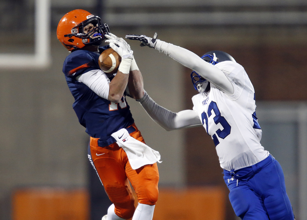 Rochester's Jeremy Bivens makes a catch in front of Chicago Phillips' Jamal Brown during the Class 4A football championship game at Memorial Stadium Friday, Nov. 28, 2014. Ted Schurter/The State Journal-Register