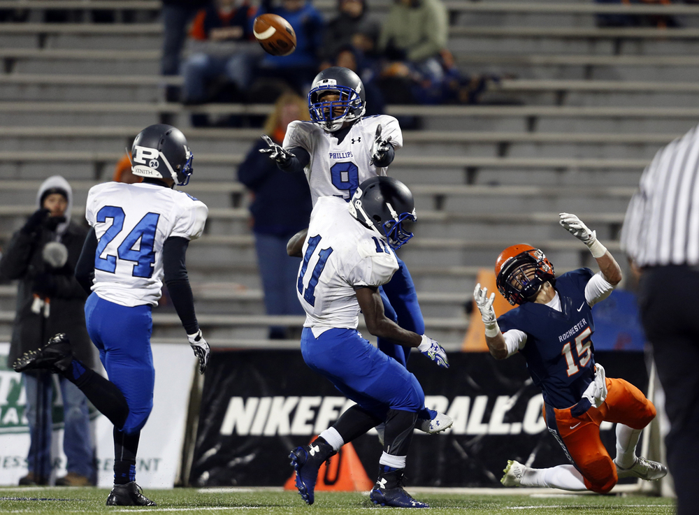 Chicago Phillips' Quayvon Skanes nearly intercepts a pass intended for Rochester's  Jeremy Bivens during the Class 4A football championship game at Memorial Stadium Friday, Nov. 28, 2014. Ted Schurter/The State Journal-Register