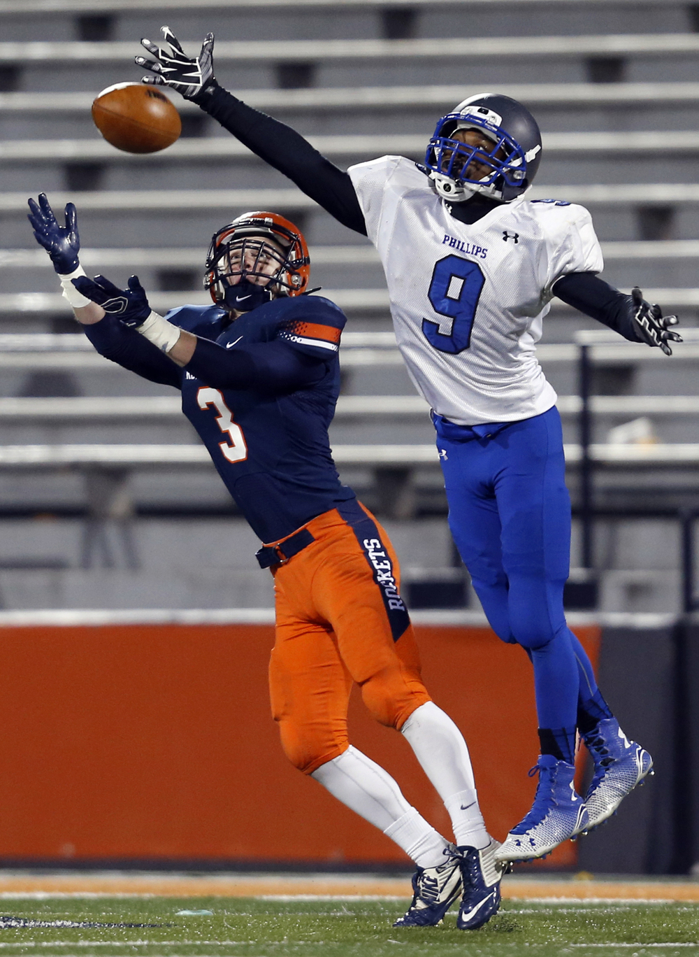 Rochester's Christian Lett tries to intercept a pass intended for Chicago Phillips' Quayvon Skanes during the Class 4A football championship game at Memorial Stadium Friday, Nov. 28, 2014. Ted Schurter/The State Journal-Register