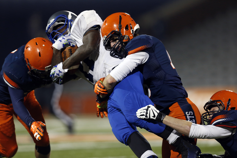 Rochester defenders wrap up Chicago Phillips' Corey Warren during the Class 4A football championship game at Memorial Stadium Friday, Nov. 28, 2014. Ted Schurter/The State Journal-Register