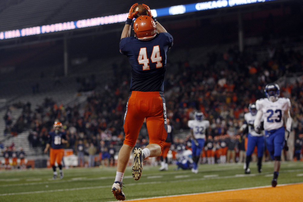 Rochester's  Collin Whitson leaps up to grab a two-point conversion against Chicago Phillips during the Class 4A football championship game at Memorial Stadium Friday, Nov. 28, 2014. Ted Schurter/The State Journal-Register
