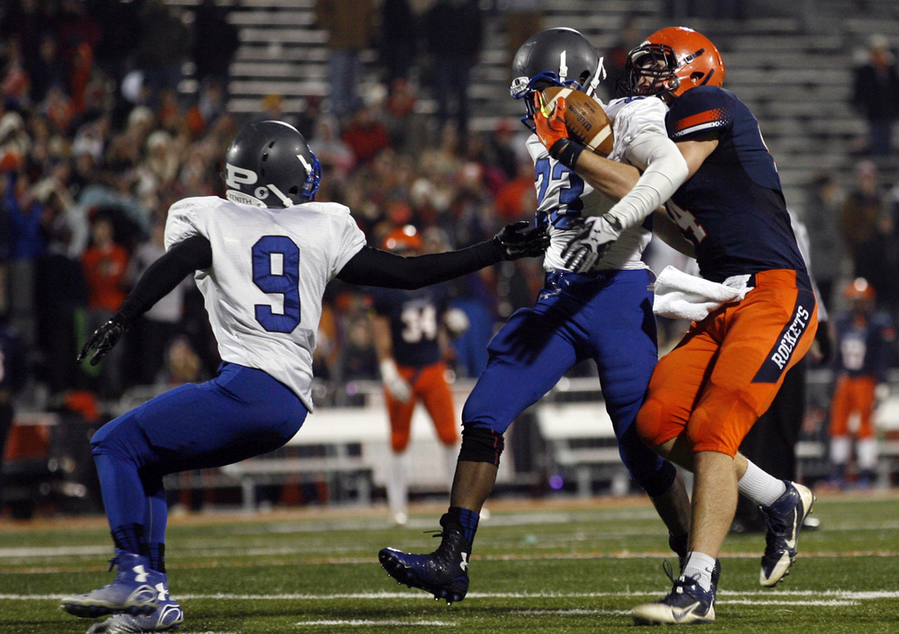Rochester's Evan Sembell and Chicago Phillips' Jamal Brown struggle for control of the ball during the Class 4A football championship game at Memorial Stadium Friday, Nov. 28, 2014. Brown was credited for an intercpetion. Ted Schurter/The State Journal-Register