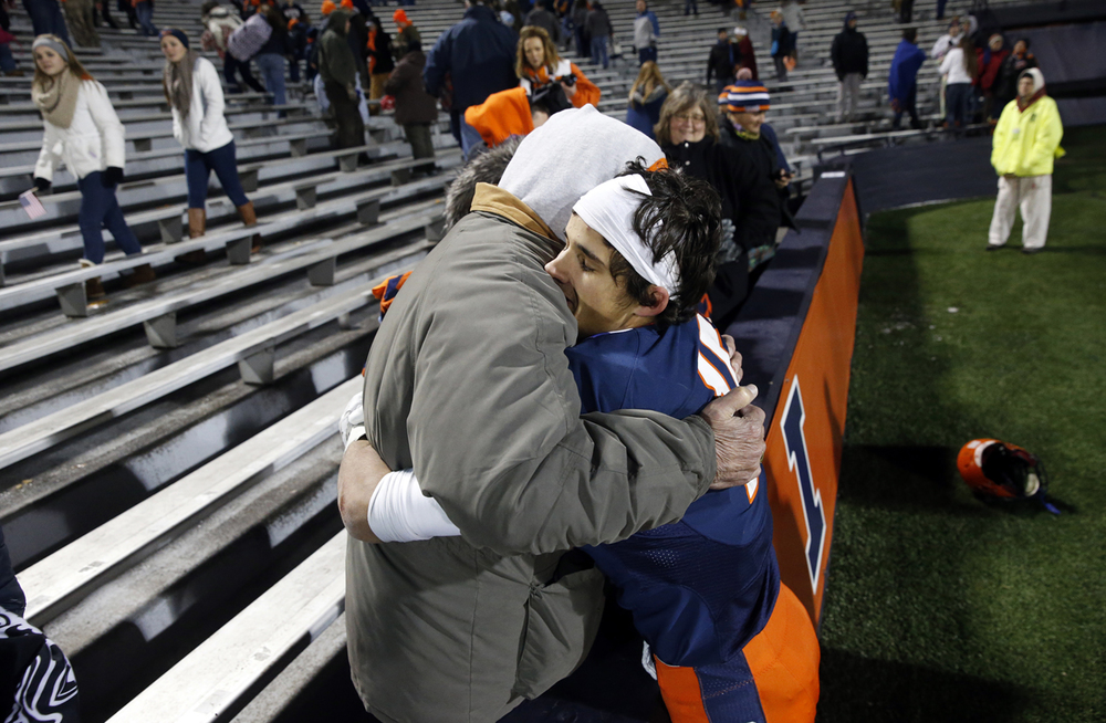 Rochester's Jeremy Bivens gets a hug from his grandfather Jack after the Rockets defeated Chicago Phillips during the Class 4A football championship game at Memorial Stadium Friday, Nov. 28, 2014. Ted Schurter/The State Journal-Register