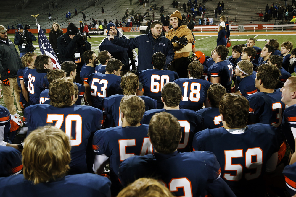 Rochester head coach Derek Leonard talks to his team after they beat Chicago Phillips during the Class 4A football championship game at Memorial Stadium Friday, Nov. 28, 2014. Ted Schurter/The State Journal-Register