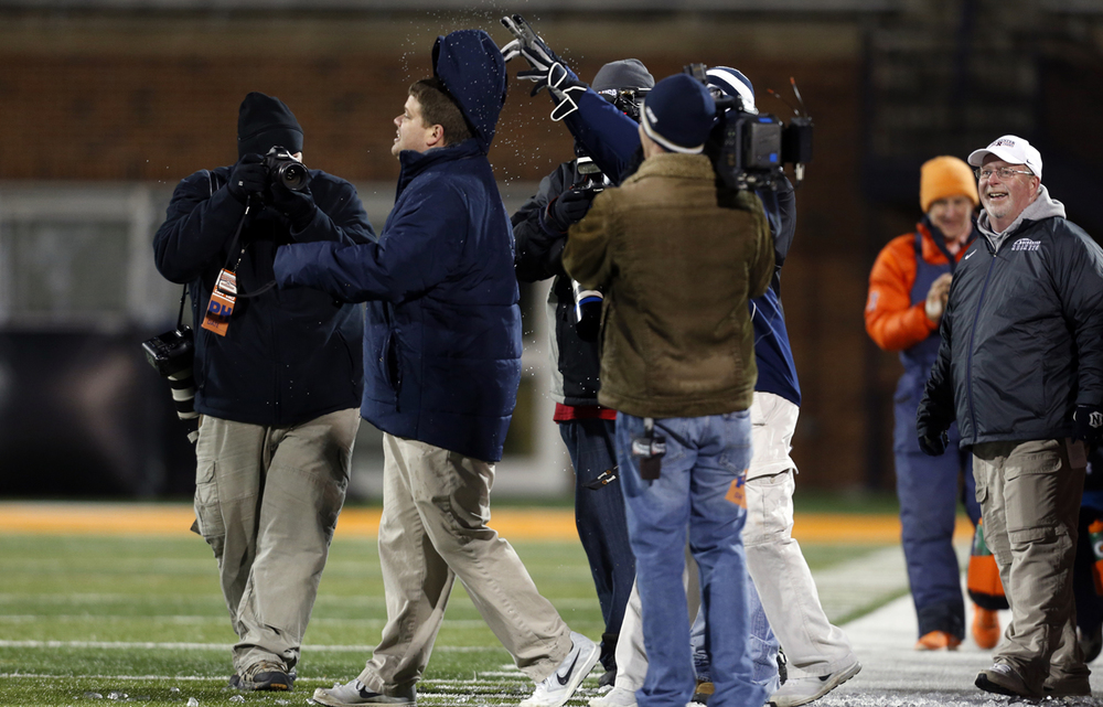 Someone flips the Gatorade soaked hood of Rochester head coach Derek Leonard's jacket back onto his head as time expires against Chicago Phillips during the Class 4A football championship game at Memorial Stadium Friday, Nov. 28, 2014. Ted Schurter/The State Journal-Register