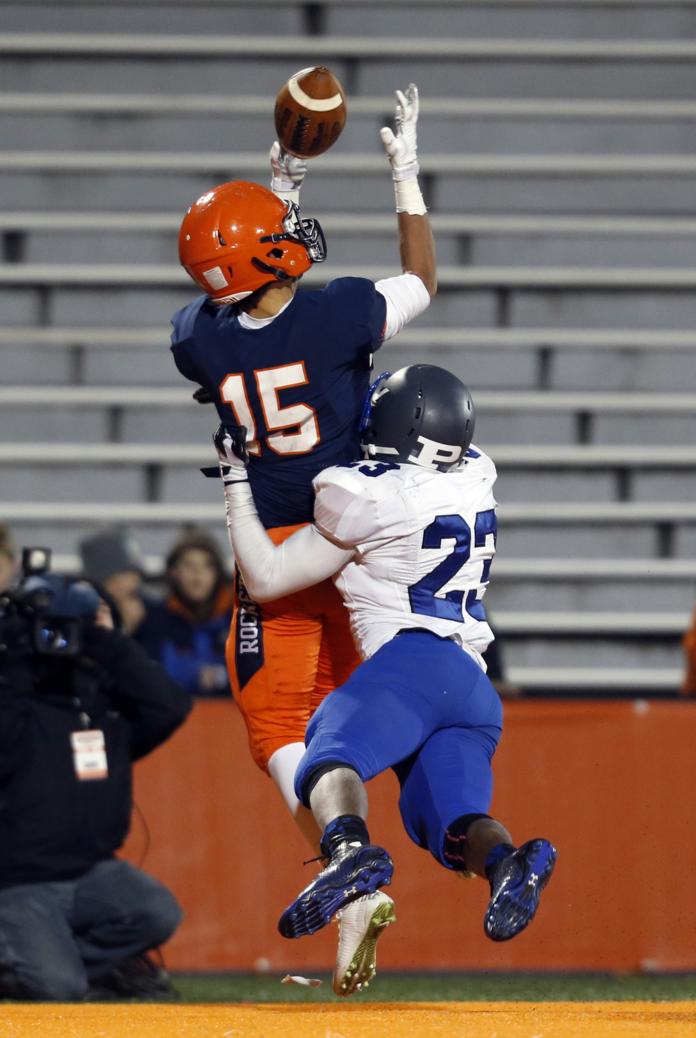 Rochester's Jeremy Bivens leaps to catch a pass in front of Chicago Phillips' Jamal Brown during the Class 4A football championship game at Memorial Stadium Friday, Nov. 28, 2014. The pass was incomplete. Ted Schurter/The State Journal-Register