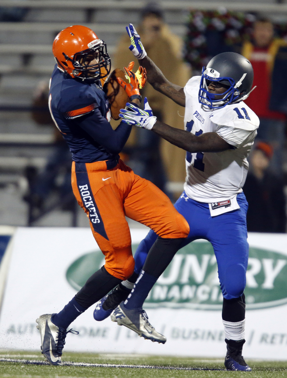 Rochester's Collin Stallworth bounches off Chicago Phillips' Corey Warren on his way to the endzone during the Class 4A football championship game at Memorial Stadium Friday, Nov. 28, 2014. Ted Schurter/The State Journal-Register