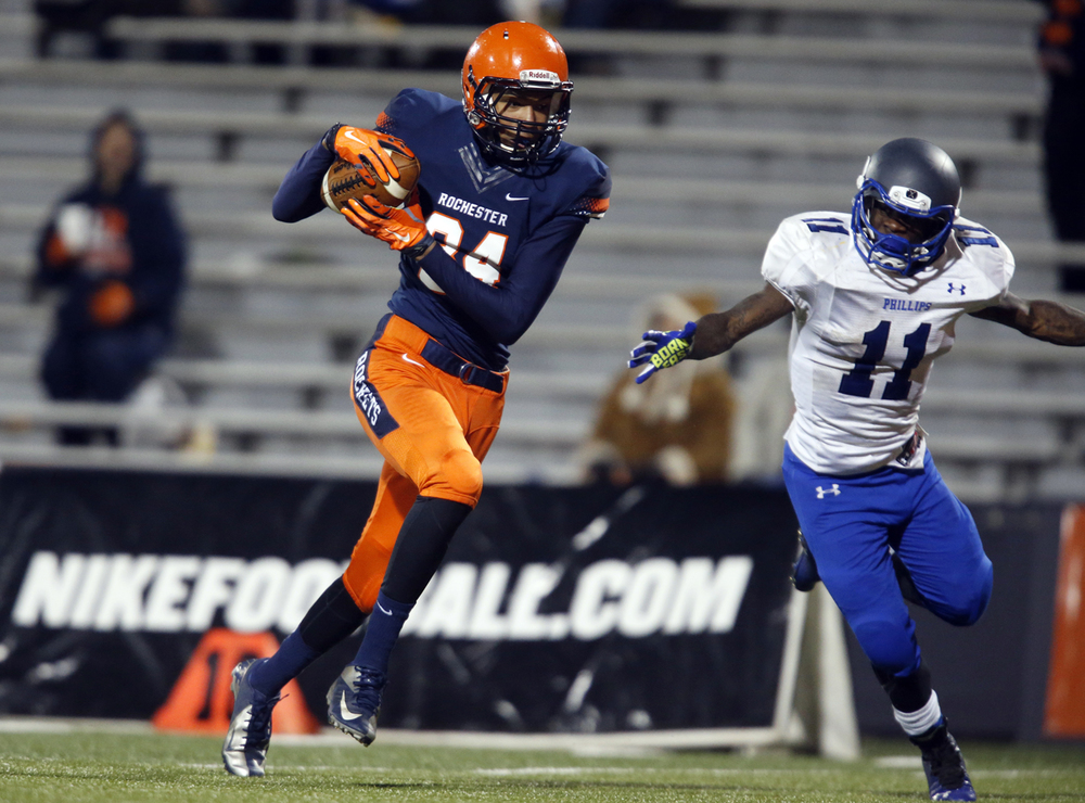 Rochester's Collin Stallworth sprints in for a touchdown in front of Chicago Phillips' Corey Warren during the Class 4A football championship game at Memorial Stadium Friday, Nov. 28, 2014. Ted Schurter/The State Journal-Register