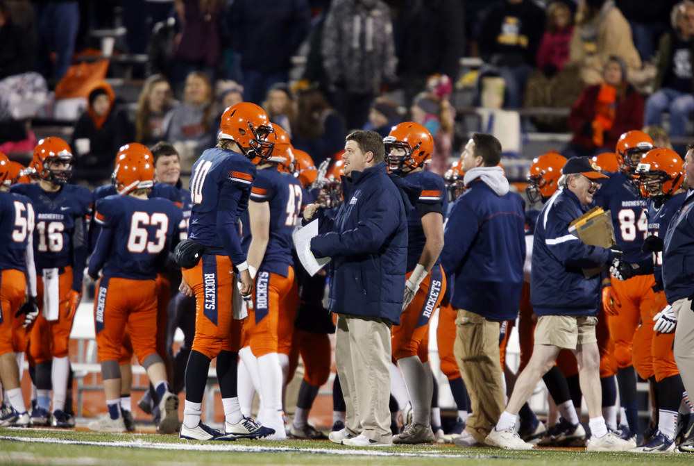 Rochester's Danny Zeigler talks with head coach Derek Leonard during their game against Chicago Phillips during the Class 4A football championship game at Memorial Stadium Friday, Nov. 28, 2014. Ted Schurter/The State Journal-Register