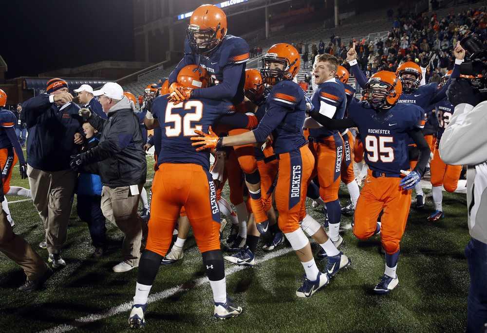 The Rochester Rockets take the field as they celebrate their win against Chicago Phillips during the Class 4A football championship game at Memorial Stadium Friday, Nov. 28, 2014. Ted Schurter/The State Journal-Register