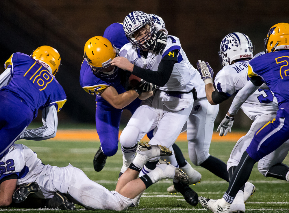 Wilmington quarterback Mason Southall (1) is brought down by Williamsville's John Karras (65) on a rush in the second half during the IHSA Class 3A state championship game at Memorial Stadium, Friday, Nov. 28, 2014, in Champaign, Ill. Justin L. Fowler/The State Journal-Register