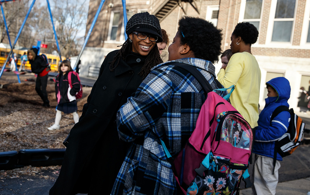 "Vykye Johnson, a Parent Educator at Harver Park, meets with parents and students after school at Harvard Park Elementary School, Tuesday, Nov. 25, 2014, in Springfield, Ill. Johnson creates a dialogue with the parents to help gain insight on how to help students perform their best as a part of the school's ÒHelp us, Help You"" program. Justin L. Fowler/The State Journal-Register"