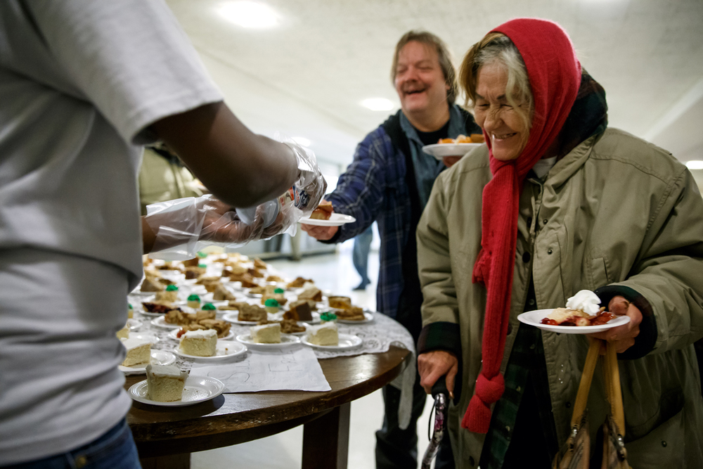 "Rosemary Sugent smiles as she picks up a piece of pie from the desert table after getting a meal with all the fixings during the Central Baptist Church's 29th Feast of Plenty free Thanksgiving meal to the public at the church, Thursday, Nov. 27, 2014, in Springfield, Ill. ""Most of my family is out of town...this is just a good way of fellowship and not being alone on Thanksgiving,"" said Sugent of her second year attending the meal. Justin L. Fowler/The State Journal-Register"