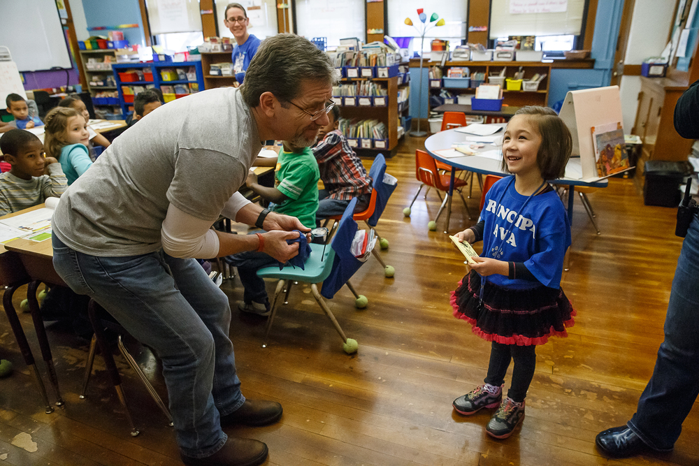 Ava Moore, 5, serving as principle for the day, denies a joking request from David Curry, a special education resource teacher, to take the rest of the day off as she makes her morning rounds with Principal Tracy Gage at Butler Elementary School, Wednesday, Nov. 26, 2014, in Springfield, Ill. Justin L. Fowler/The State Journal-Register