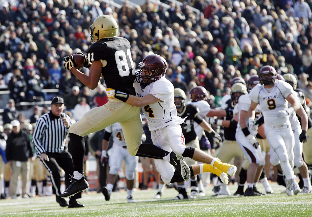Sacred Heart-Griffin's Albert Okwuegbunam grabs a pass in front of Montini's Mitch West to set up a SHG touchdown during the Class 5A football championship game at Memorial Stadium Saturday, Nov. 29, 2014.  Ted Schurter/The State Journal-Register