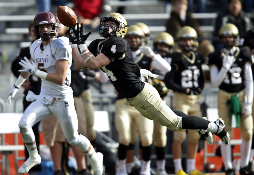 Sacred Heart-Griffin's Austin Sommer nearly makes a diving interception in front of Montini's Tyler Millikan during the Class 5A football championship game at Memorial Stadium Saturday, Nov. 29, 2014. Ted Schurter/The State Journal-Register