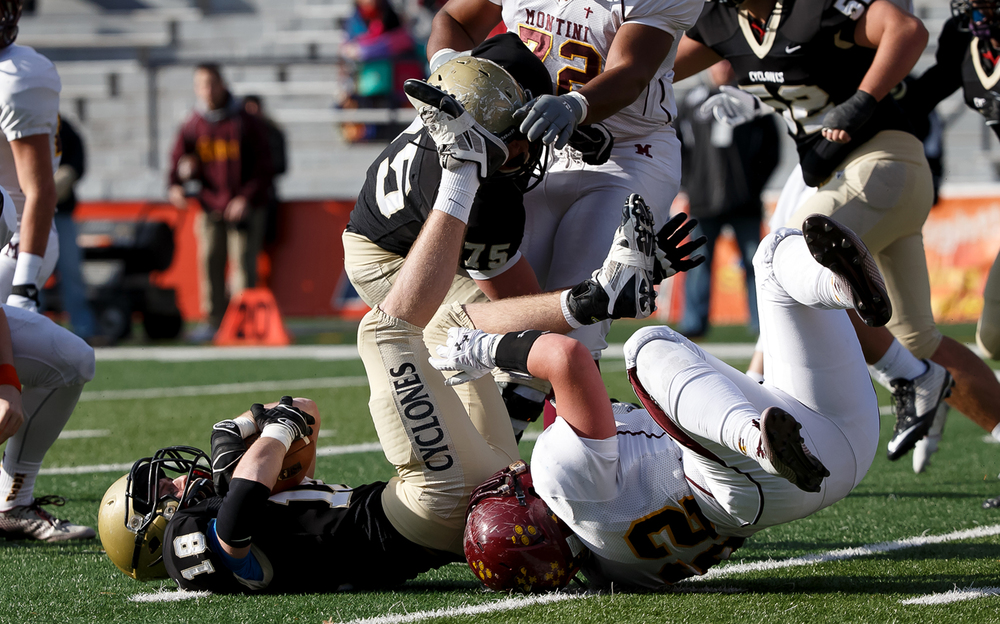 Sacred Heart-Griffin's Cole Hillestad (18) makes an interception against Lombard Montini near the goal line in the first half during the IHSA Class 5A state championship game at Memorial Stadium, Saturday, Nov. 29, 2014, in Champaign, Ill. Justin L. Fowler/The State Journal-Register